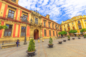 Seville, Andalusia, Spain - April 18, 2016: facade of Archbishop's palace in Plaza Virgen De Los Reyes square. Seville is an artistic city and tourist destination.
