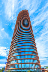 Seville, Andalusia, Spain - April 19, 2016: Sevilla Tower skyscraper or Torre Sevilla with panoramic view, is the tallest building and a 5-star hotel in Andalusia and seventh tallest in Spain.