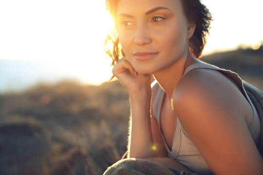 Beautiful woman. Portrait of a beautiful young girl at sunset. High quality photo.