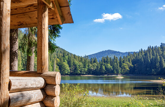 Wooden log house on the shore of a picturesque lake.