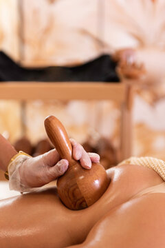 Madero therapy. Woman on anti cellulite massage treatment. Close up. Copy space. Female on the massage table next to her is wooden massage tools for Maderotherapy.
