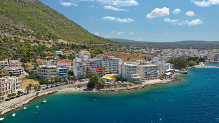Aerial drone photo of famous seaside area, organised beach and bay of Loutraki town, Corinthian bay, Greece