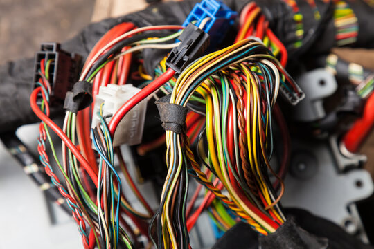 A cable of matted wires of different colors with connectors in the electrical wiring of the car. Internet line in the work of the provider.
