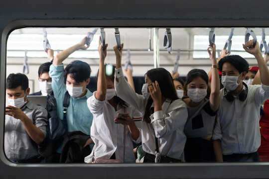 Crowd of passengers on Urban Public Transport Metro. .Asian people go to work by public transport. Face Mask protection against virus. Covid-19, coronavirus pandemic