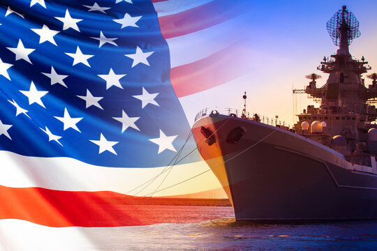 An American ship is moored in the Harbor. Ship on the background of the us flag. American fleet. The naval forces of America. us army. Participation of ships in military conflicts.