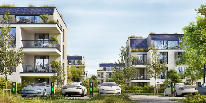 Modern residential buildings with solar panels.  Low-energy houses and electric car parking