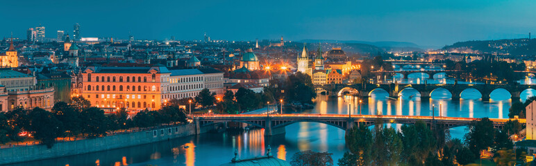 Prague, Czech Republic. Panoramic View Of Prague Cityscape Skyline During Twilight Dusk Evening Night Time. Famous Beautiful Travel Destination