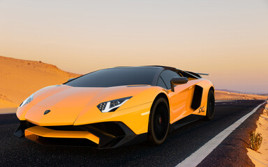 Lamborghini Aventador on a high-speed road across the dunes