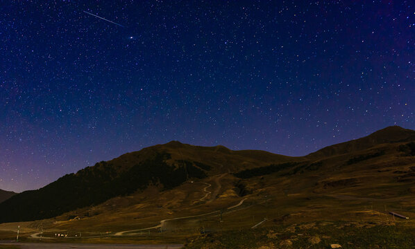Panoramic shot of a mountain landscape on a stary night background