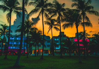 sunset at the beach ocean drive miami palms buildings