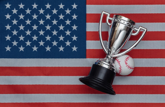 Champion cup with basebal ball on USA flag. Sport competitions