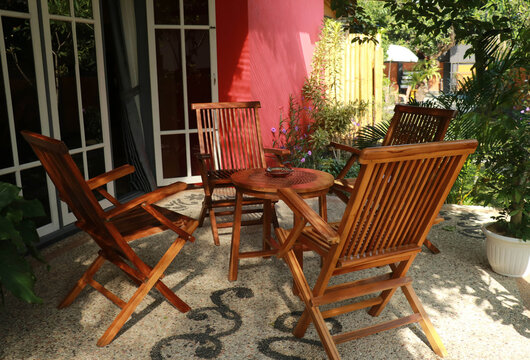 tables and chairs in a small restaurant.outdoor cafe. sitting wooden folding armchair