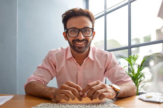 Man smiling in front of desktop