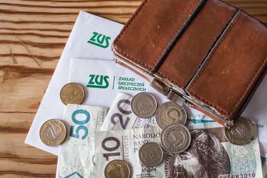 ZUS logo (polish Social Insurance Institution) and money