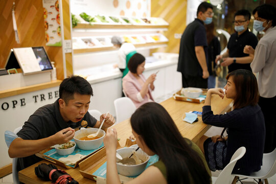 Customers eat lunch at a Hope Tree restaurant which is offering plant-based meatballs produced by Zhenmeat in Beijing