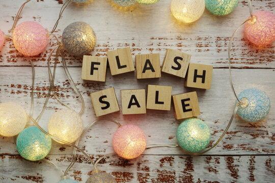 Flash Sale alphabet letter and LED cotton balls on wooden background