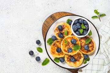 Cottage cheese pancakes on white.