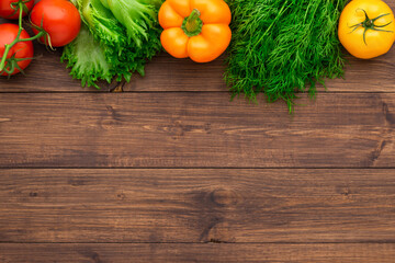 Healthy eating ingredients: fresh vegetables, fruits and superfood. Wooden background