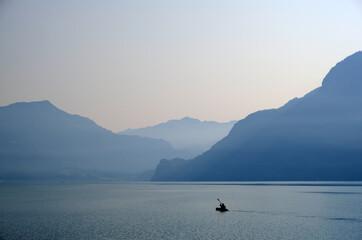 Single kayakker on Brienzersee lake near Interlaken, Switzerland, early morning