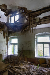 Interior of a living room with a collapsed ceiling