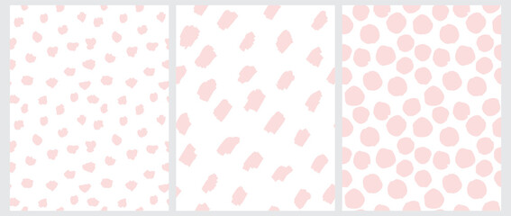 Cute Pastel Color Geometric Seamless Vector Patterns. Light Pink Hand Drawn Polka Dots and Spots on a White Background. Lovely Infantile Irregular Doodle Print.