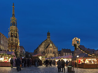 Nuremberg, Germany. Christkindlesmarkt Christmas market at Hauptmarkt platz (Main Market Square) in dusk.