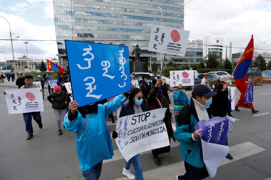 Demonstrators take part in a march against China's changes to school curriculums that remove Mongolian language from core subjects, in Ulaanbaatar
