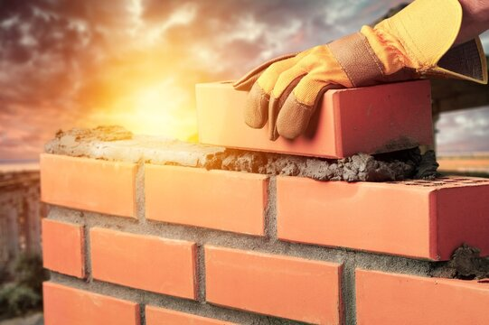 Bricklayer build cement masonry layer