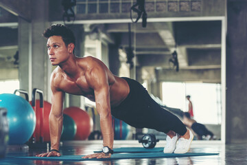 Trainer man exercise for  functional plank training and cross fit the gym workout for healthy care and body building.  Fitness instructor exercising the fitness. Healthy sport Concept