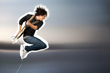 Male guitarist playing music on guitar and jump