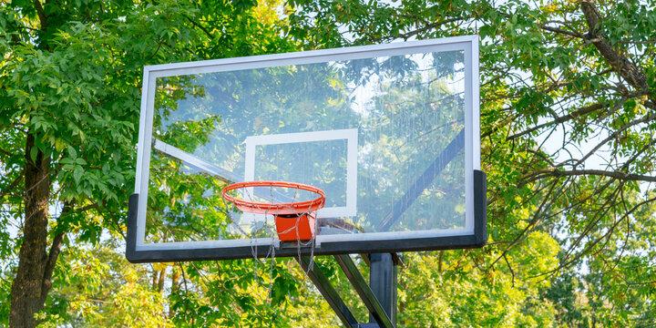 plastic transparent backboard for basketball game in urban park closeup