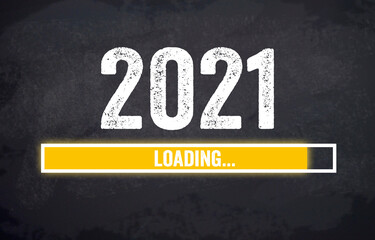 Black chalkboard with yellow loading bar and message Loading 2021