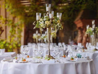 decorated table with candles and flowers in a luxury restaurant