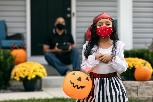 Halloween: Trick Or Treater With Parent On Porch