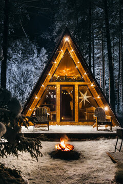 Cozy a-frame house at night