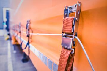 Attaching the awning of the cargo trailer closeup. Fotobehang