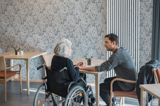 Man visiting grandmother at the nursing home