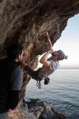 Rock climbing an overhang