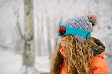 Teen Girl In Snow Wearing Snow Gear