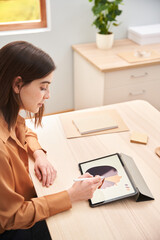 Young freelancer drawing picture on tablet
