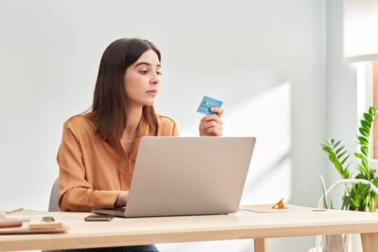 Young lady making online transaction