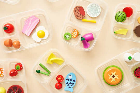 Set of toy lunch boxes with various food