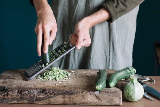 Closeup Of Man's Hands Preparing Vegetarian Filling For Dumplings