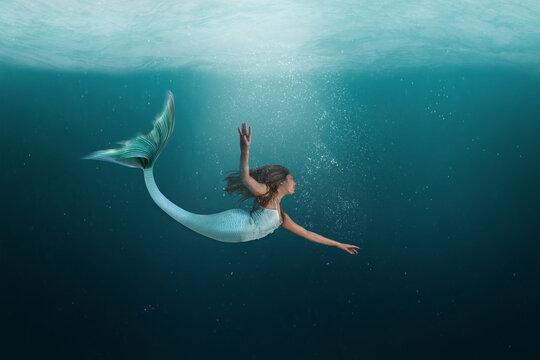 Underwater Mermaid Dancing Gracefully in the Ocean