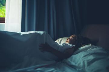 Preschooler lying in bed