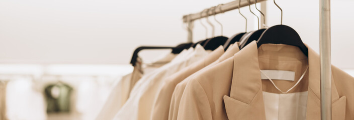 Banner for women's clothing store in beige colors. Selective focus, copy space