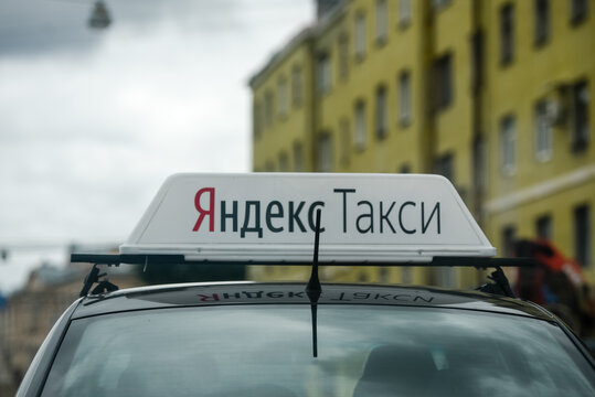 Russia, St. Petersburg, August 2020: Yandex Taxi. Identification lights on the car roof with logo.close-up