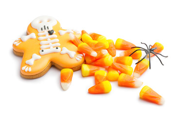 Tasty scary candies and cookie for Halloween on white background