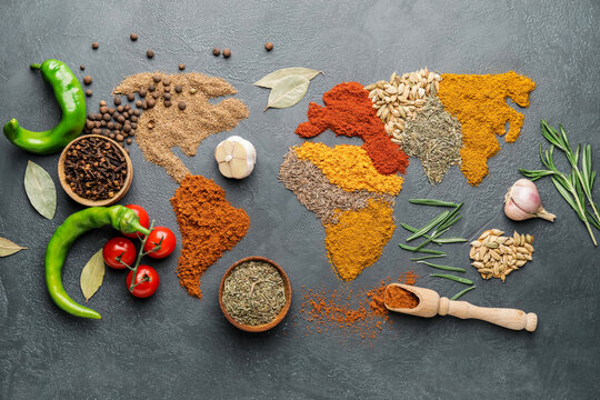 World map made of different spices on grey background