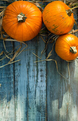 Hello Autumn. Pumpkins on Aged wooden table at sunlight - Autumn And Harvest background